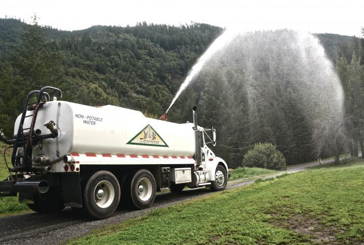 Truck shooting water
